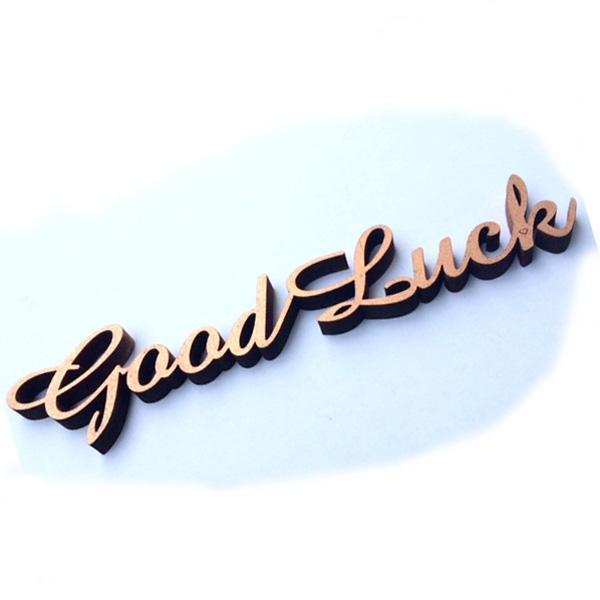 gelaserter Spruch aus Holz - good luck